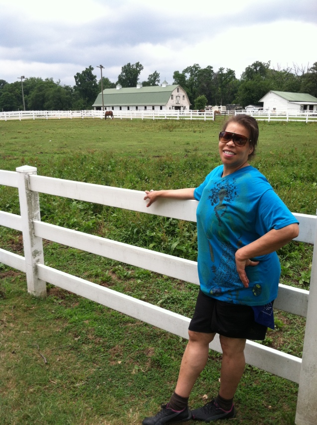 Rhonda posing with the horses.
