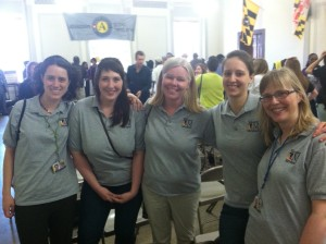 Patrice (in the middle) surrounded by people - AmeriCorps members and staff of Volunteer Maryland
